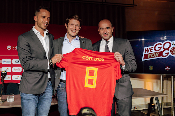 Three men holding the Côre d'Or Shirt